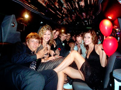 people inside the limo having birthday party