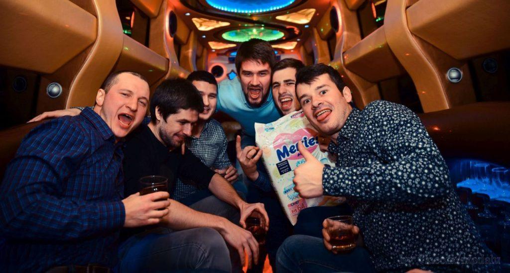 group of men inside on limo celebrating birthday