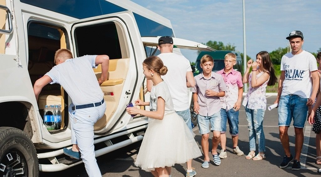 image of kids getting into limo before birthday party