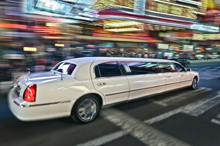 image is showing white Limousine on the street