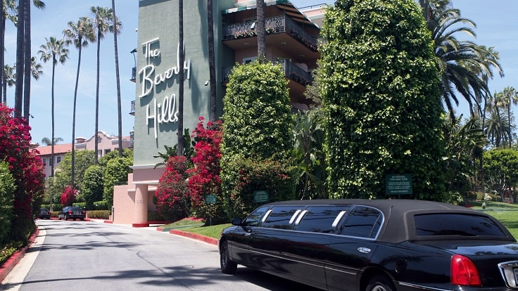image is showing Beverly Hills hotel and black limo