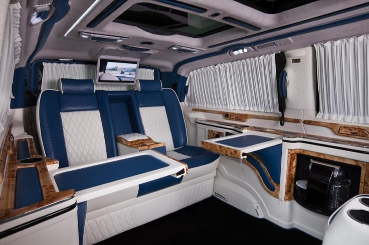 image is showing white and blue luxury interior of limo