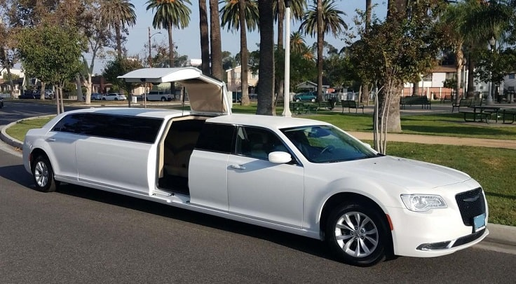 image is showing white stretch Limousine in Palm Springs reach for pick up