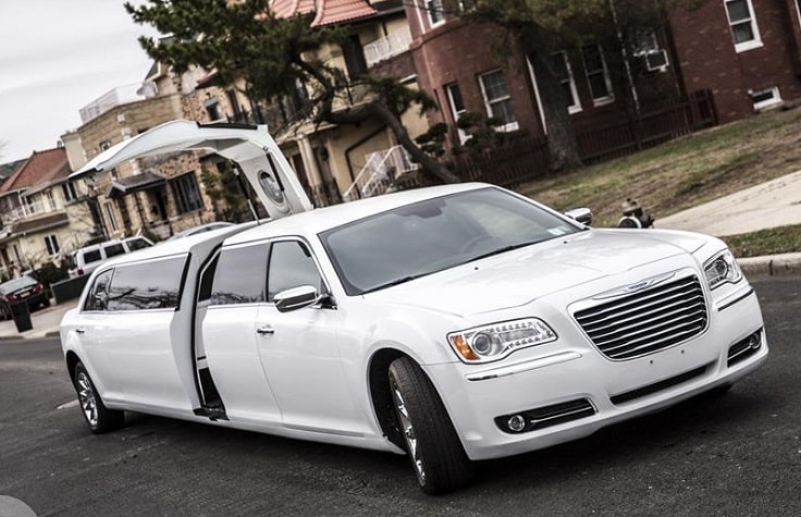 image is showing white Chrysler limo with open door