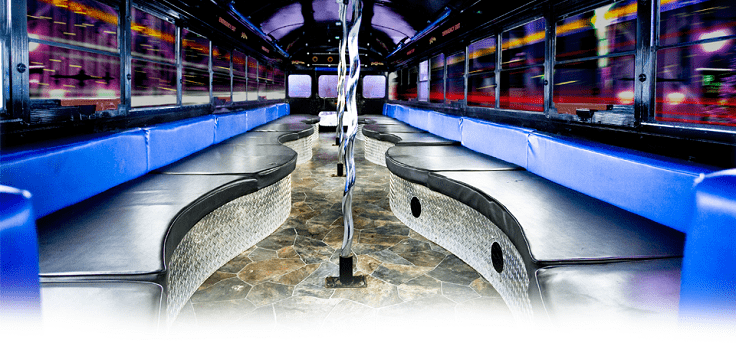 image is showing luxury party bus interior - black and blue colors