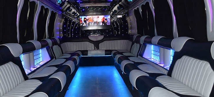 image showing grey, black with blue lighting party bus interior