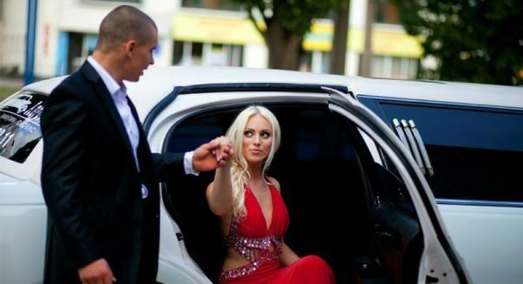 image is showing girl in red dress and white limo