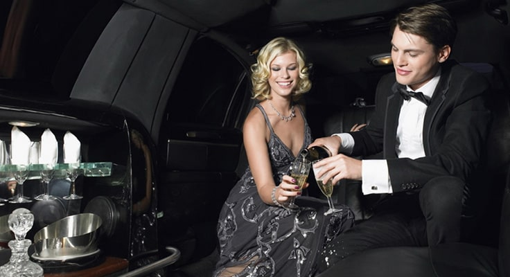image is showing couple and interior of limo