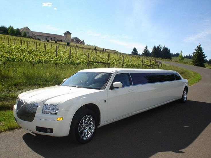image is showing white Chrysler Limousine in Santa Barbara, California