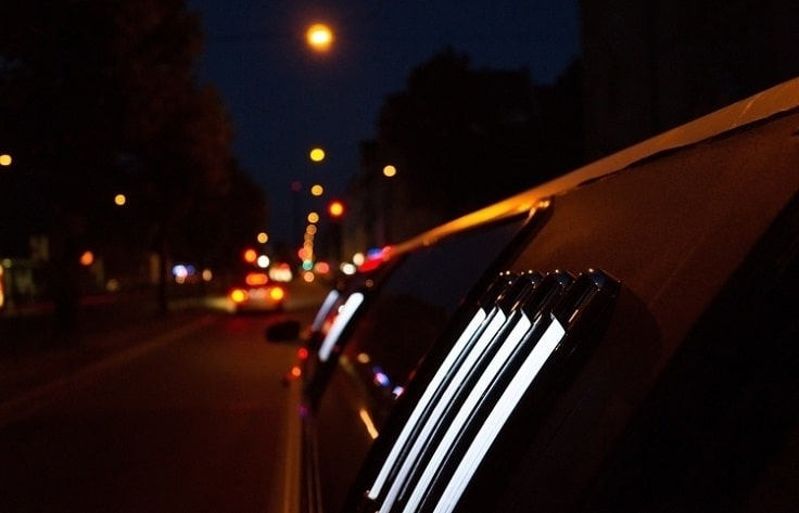 image is showing a white limo in North Hollywood at night