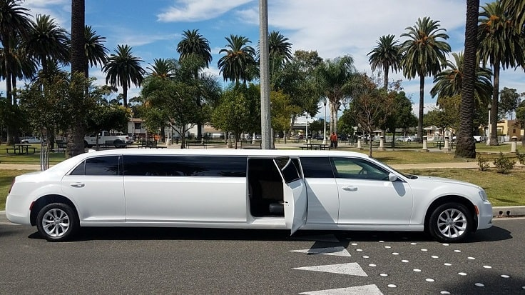 image is showing a white limo and palms in Pasadena